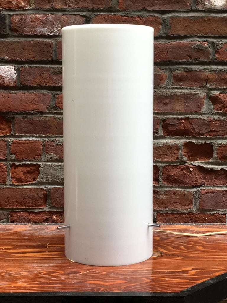 Early white cylindrical hand blown cased glass with chrome fittings. Designed by Paul Mayen and for Habitat. An early glass example before it was switched over to white Lucite or Lumacryl, circa 1960. The single bulb fixture throws off a warm,
