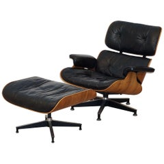 Early Production Charles and Ray Eames Rosewood Lounge Chair with Ottoman