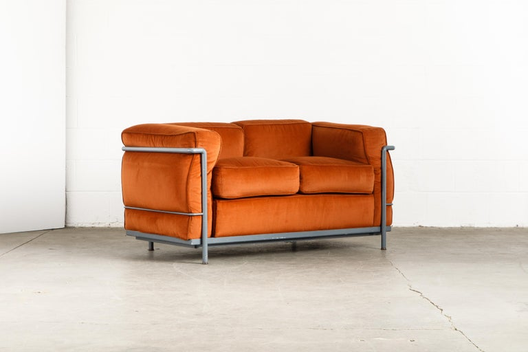 If you want the most comfortable seat to sink your heinie into, this Le Corbusier for Cassina (signed) LC2 loveseat sofa is for you (and of course, your heinie). Comfortable and form fitting, the LC2 -