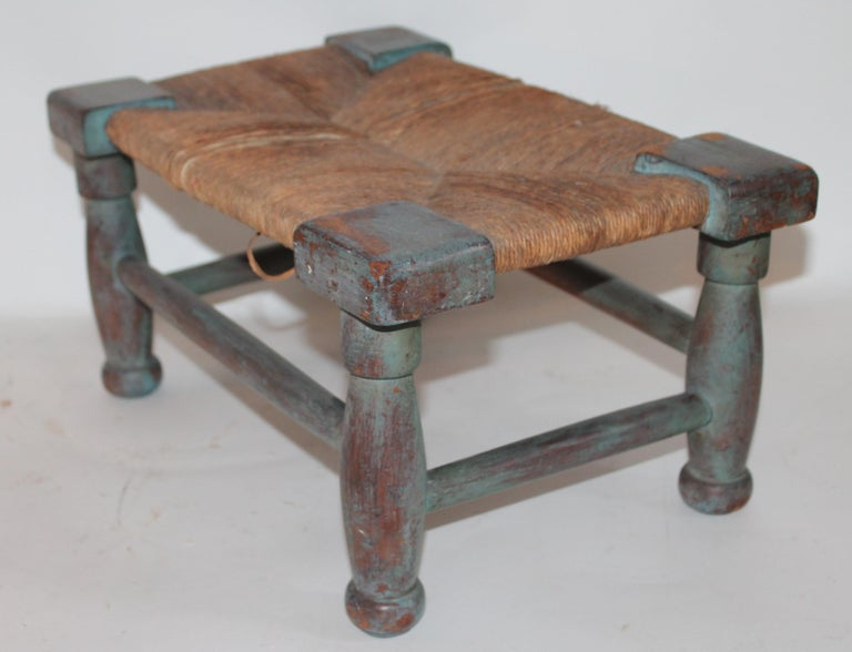 Amazing untouched robin egg blue painted 18th century handmade foot stool with the original handmade rush seat .This stool was found in the state of Maine .It is constructed of handcut nails and the best blue painted surface.
