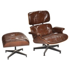 Early Ray & Charles Eames for Herman Miller Lounge Chair and Ottoman in Rosewood