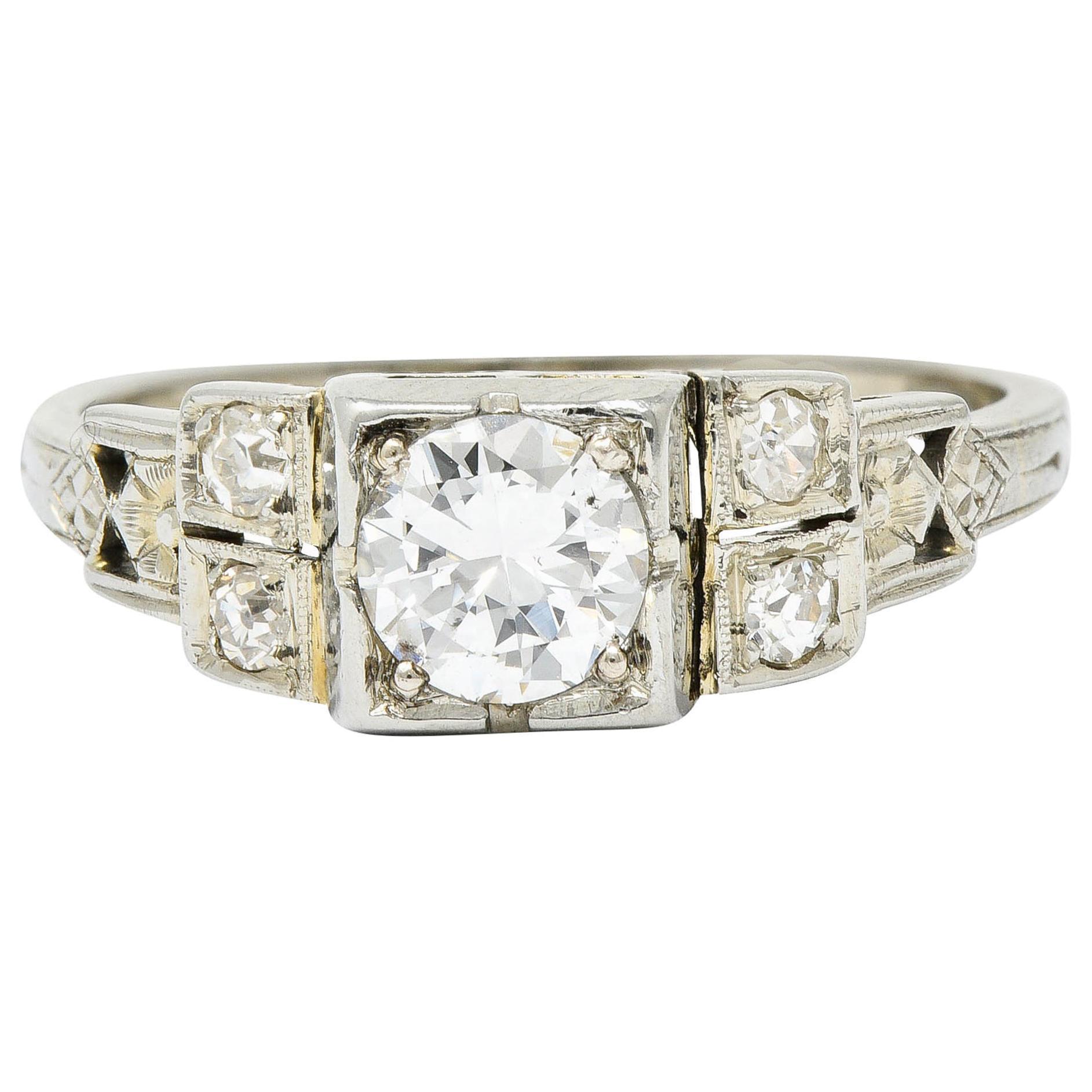 Early Retro 0.65 Carat Diamond 18 Karat White Gold Engagement Ring