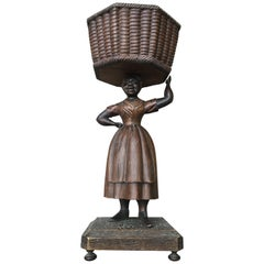 Early Wooden Sculpture of Basket-Carrying Lady