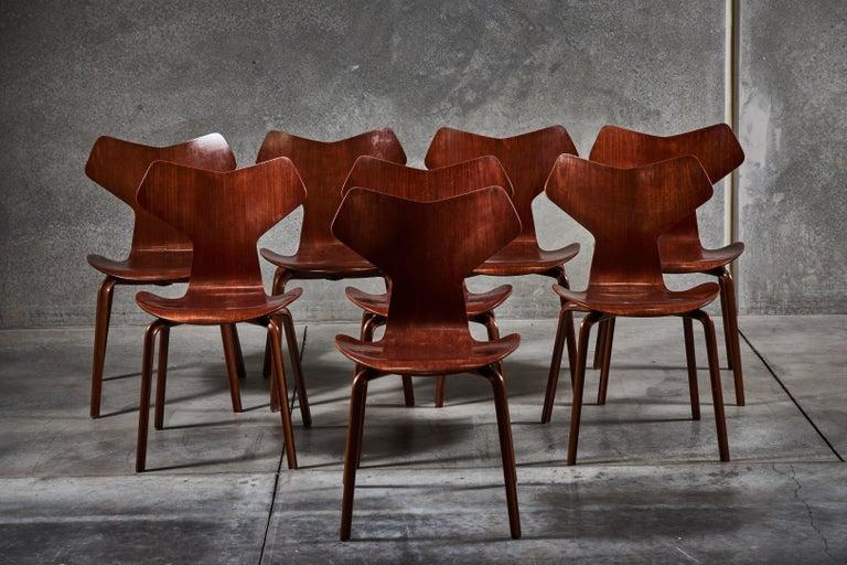 "Eight first generation model 4130 ""Grand Prix"" chairs in teak by Arne Jacobsen for Fritz Hansen. Made in Denmark circa 1957."