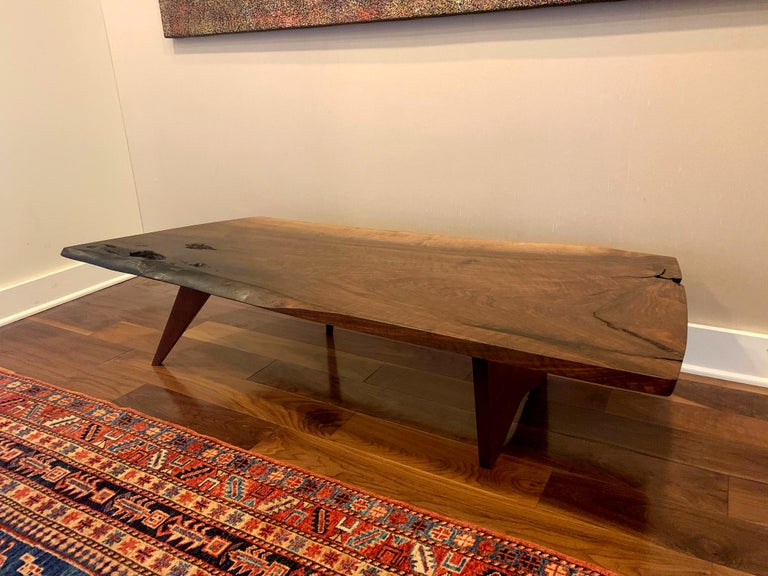 A stunning piece of furniture art by George Nakashima (1905-1990) from his early studio years circa 1958. It features a selected American walnut slab with amazing characters, finely crafted to showcase the design philosophy of George Nakashima: Let