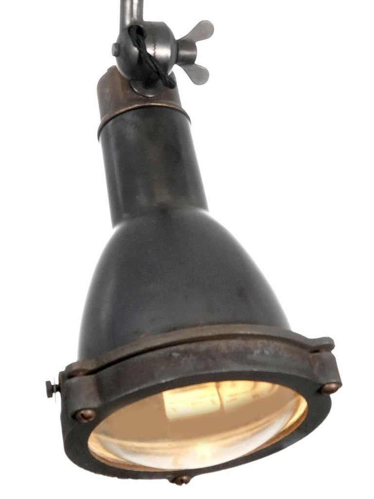 Industrial Early Spun Copper and Cast Brass Articulated Spot Light For Sale