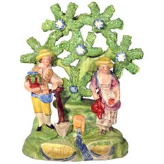Early Staffordshire Bocage Figure Group of Gardener and Companion, circa 1825
