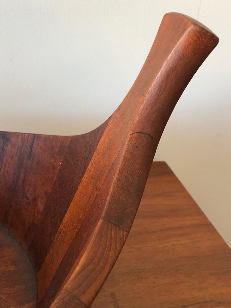 A rare and hard to find, large teak bowl by J.Quistgaard. Unusual form with raised handles and great patina.