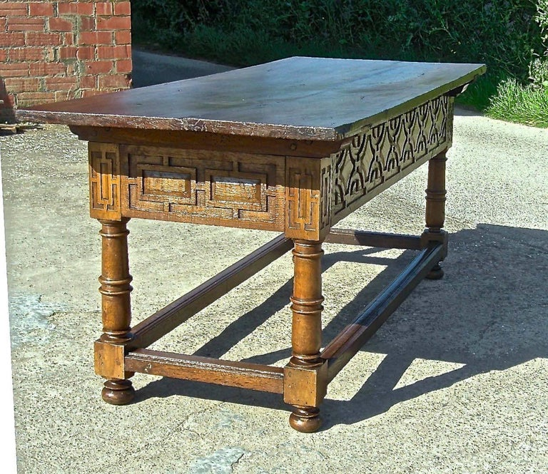 An impressive early to mid-17th two-drawer mixed wood library table from the historic town of Viana in the province of Navarra, Spain.  With a massive single-board walnut top measuring 78 1/8