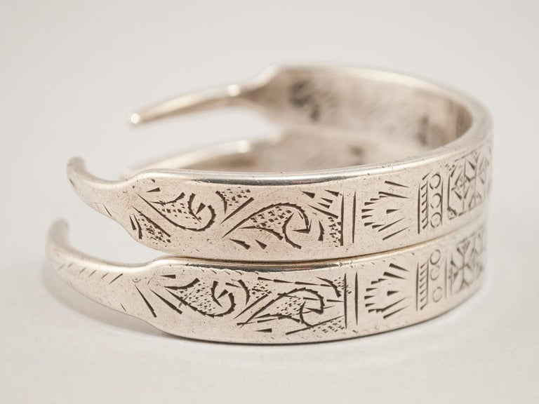 Early to mid-20th century pair of silver bracelets, Tunisia or Libya  These 'bracelets' were converted from an old pair of ear hoops; they are not attached, just stacked for the photo. The cartouche with the initials D.B is the hallmark of a master