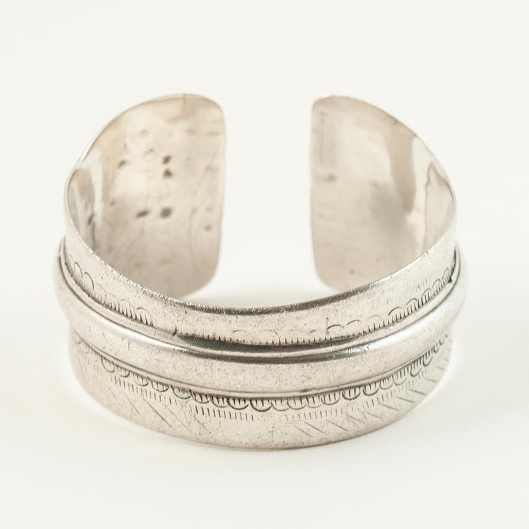Early to mid-20th century Tribal Bedouin silver cuff, Tunisia.  A graceful asymmetric curve from a woman's wrist bone has been worn into this Berber cuff; the number 8 is stamped on the interior. 7 15/16