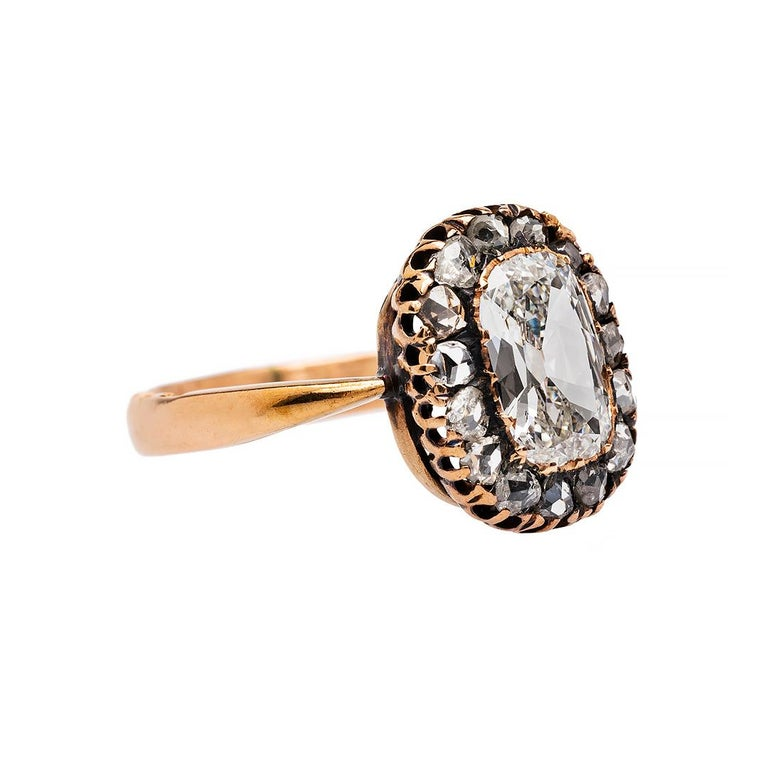 This is an extraordinary and authentic Early Victorian (circa 1845) 14k rose gold ring. This true antique ring has amazingly vivid Russian Hallmarks on the edge of the shank. Wrightwood centers a fifteen prong set diamond accompanied by EGL
