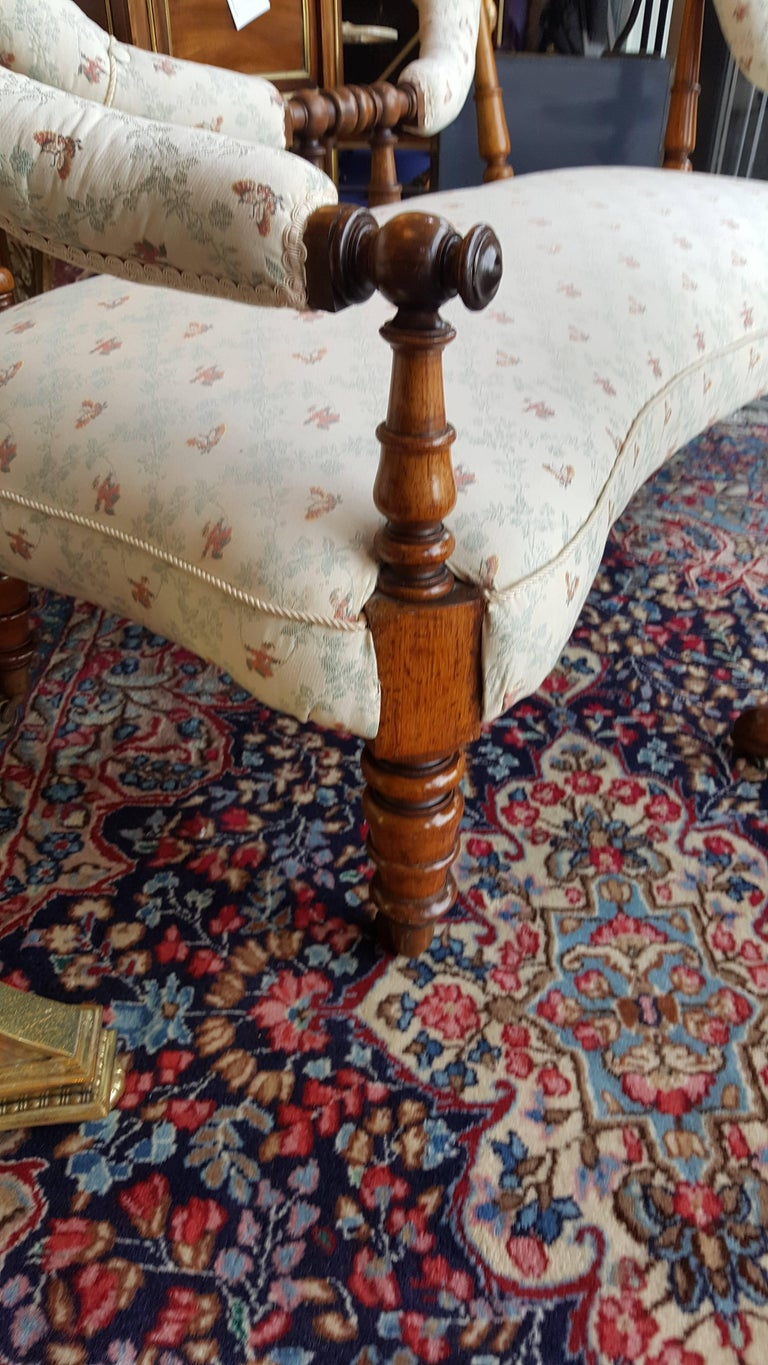 Early Victorian rosewood two-seat settee of serpentine shape. Measures: 63