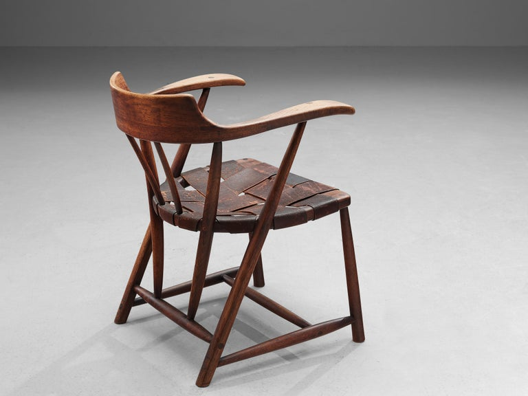 Wharton Esherick, 'Captain's Chair', American walnut, brown leather, United States, 1951  This beautiful 'Captain's Chair' is a striking example of American designer Wharton Esherick's oeuvre. The chair is one of the first ones ever made as it was