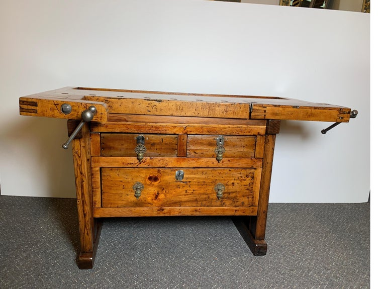 Early workbench with maple top, two vices, one dog, and three drawers. professionally restored.