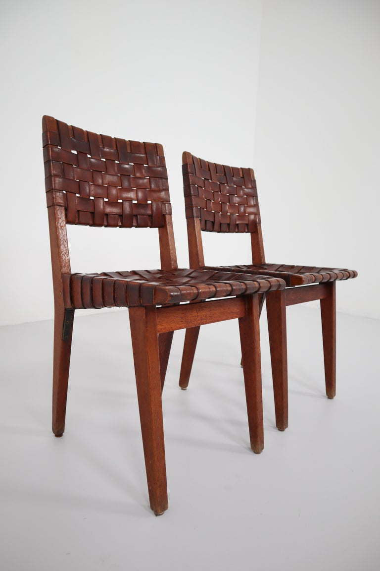 Early woven leather side chairs model No. 666 by Jens Risom for Knoll from the 1940s . Structure in solid oak. Backrests and seating's in leather brown braids. In good original condition. Amazing patine.