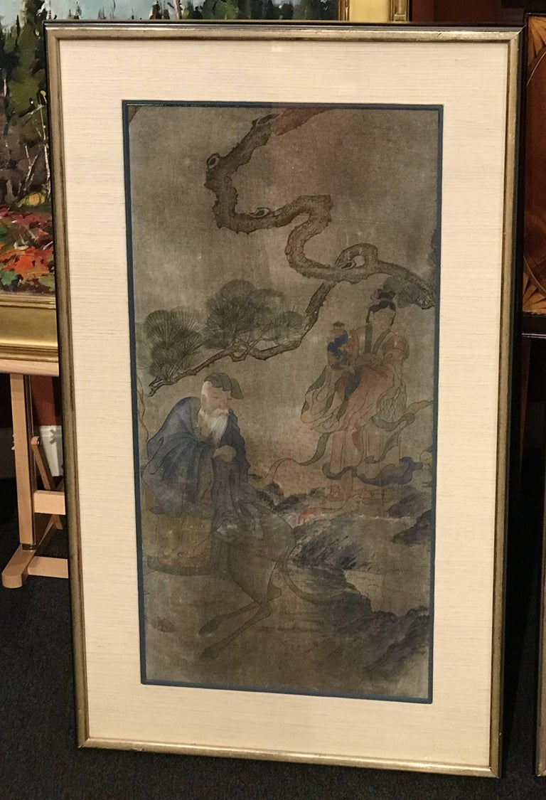 A fine hand-painted three-panel triptych on fabric, possibly silk, featuring folklore scenes with figures, horses, and landscapes from the Yi dynasty of Korea, probably dating to the 19th century. matted in linen mats with a gray highlight, under