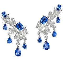 Earrings crafted in 18K White Gold, White Diamonds and Blue Sapphires