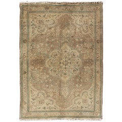 Earth Tone Vintage Persian Tabriz Rug with Swirling Garden Pattern and Medallion
