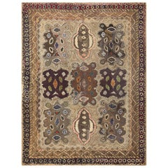Earthy Antique American Hooked Rug. Size: 6 ft 6 in x 8 ft 9 in