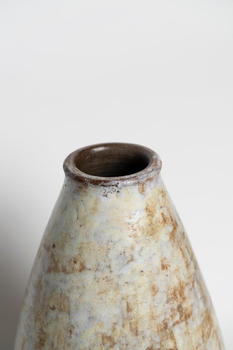 Earthy colors midcentury ceramic vase by Alexandre Kostanda. Signed: