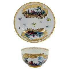 Eary 19th Century Meissen Cup and Saucer with Kauffahrtei Scenes and Gold Decor