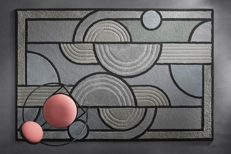 Rock arrangements, raked gravel and rippled sand of a Zen garden reconfigured in pure geometric form in the signature style of Lara Bohinc; a mix of contradictions: bold yet light, graphic yet fluid, angular yet feminine. A hand tufted rug of finest