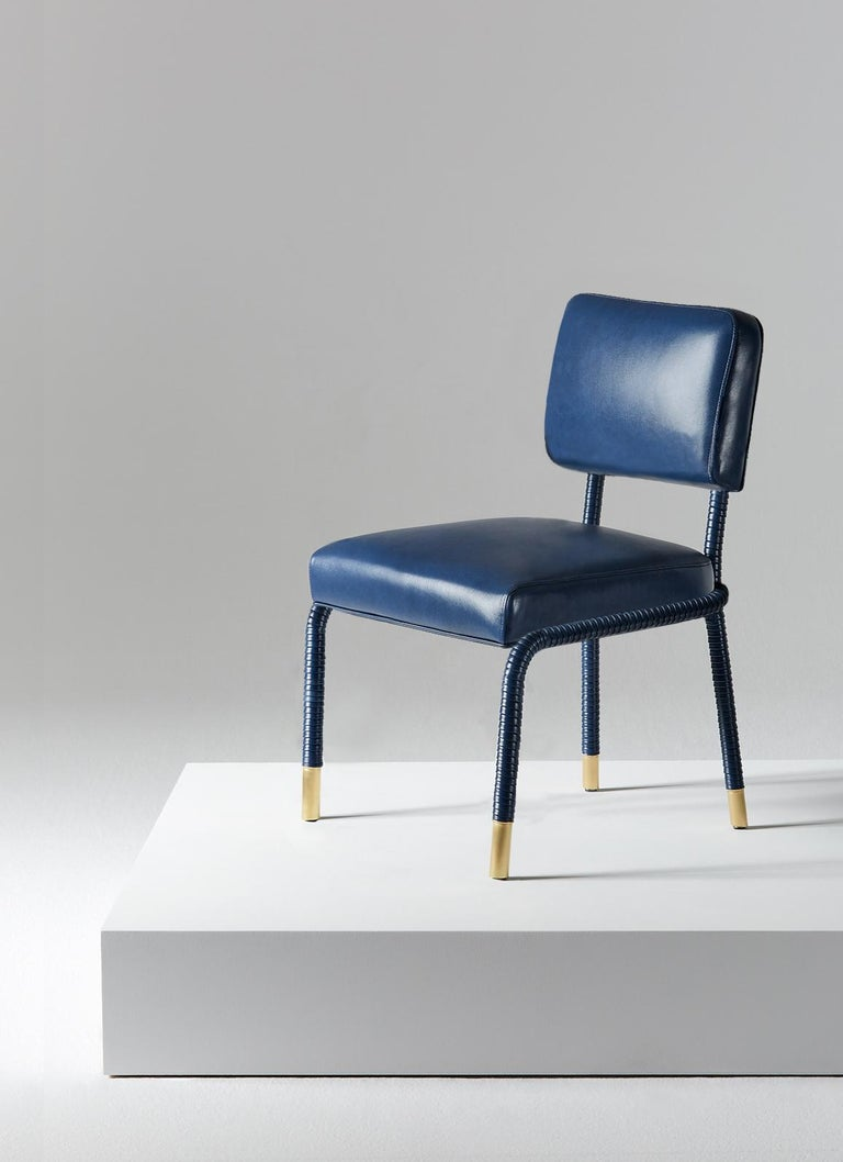 And Objects, product design studio founded by Martin Brudnizki and Nick Jeanes based in London.  The Easton side chair is uniquely crafted from stainless steel and Italian leather. Hand-wrapped leather cloaks a tubular frame ending with brass accent