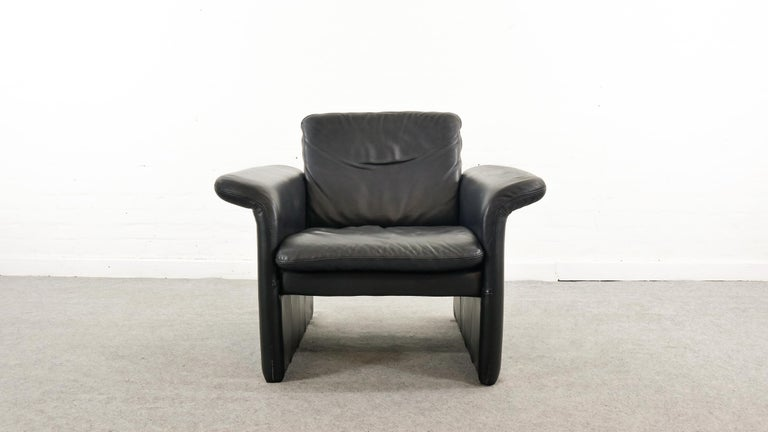 Scandinavian easy chair / armchair / club chair from the 90s by SKALMA, Denmark. Upholstered in original black Leather. Good condition. Marked with Manufacturer Tag.