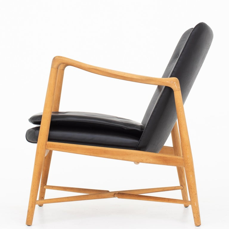 BO 59, easy chair in beech and patinated black leather. Designed 1947. Maker Bovirke.
