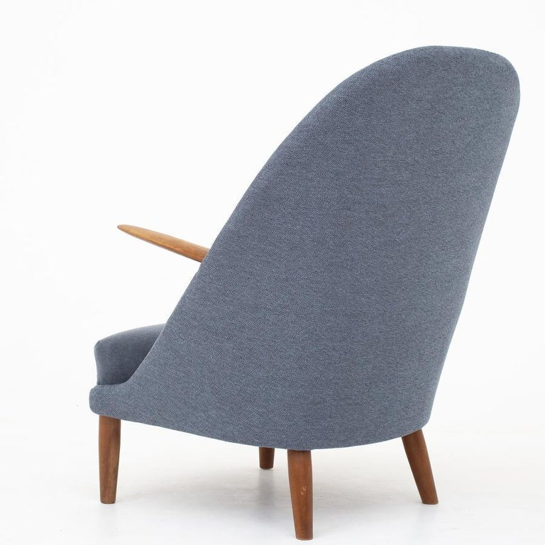 Easy chair in new wool (Clay, code 001 and seat in Byram, code 171). Frame of beech. Maker Rolshau Møbler.