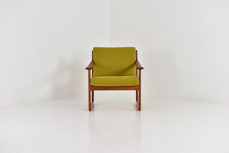 Easy chair by Peter Hvidt and Orla Molgaard-Nielsen for France & Søn, Denmark 1960's. This is model FD130 made out of teak and the cushions has been professionally re-upholsterd in a mosterd green fabric. Labeled.
