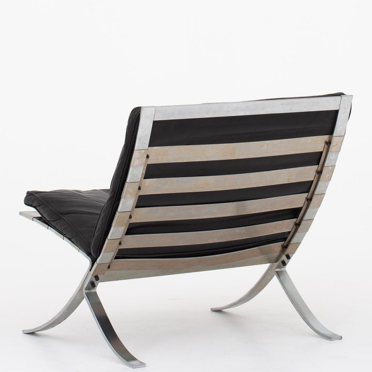 Tango easy chair in original, black leather and frame of steel. Maker Terrex Art. Designed 1968.