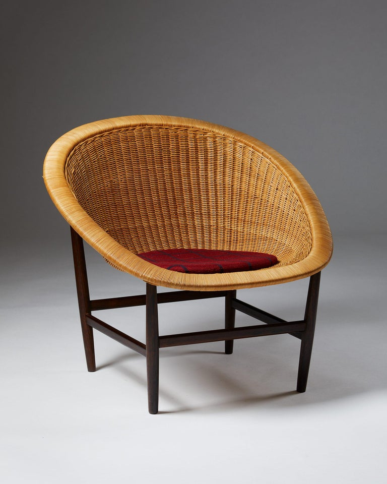 Exceptionally rare model with rosewood frame. Woven cane, wool cushion.  Provenance: Ludvig Pontoppidans nephew, thence by descent in the family.  Model presented at The Copenhagen Cabinetmakers' Guild Exhibition at Designmuseum Danmark, 1950.