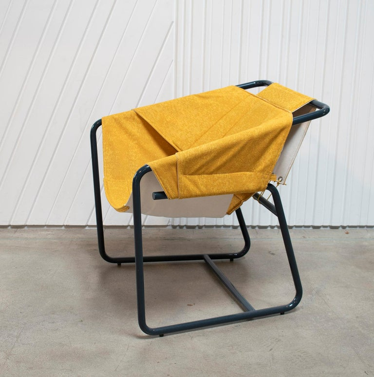 The easy chair combines the casual vibe of sling chairs with the cozy comfort of a classic club chair all in a floating form reminiscent of midcentury shell chairs. The top layer of the quilted sling is available in a choice of upholstery fabrics