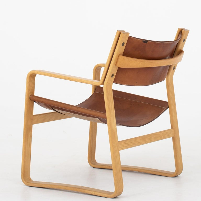 Easy chair in ash with original, patinated natural leather. 4 chairs in stock. Maker Johannes Hansen.
