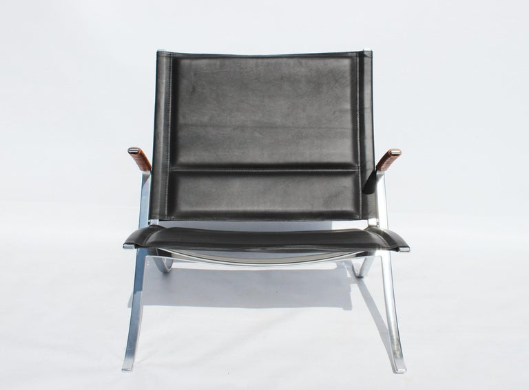 Easy chair, model FK82 - X-chair, designed by Preben Fabricius and Jørgen Kastholm in 1968 and manufactured by Lange Production. The chair is upholstered with black leather and is in good condition.