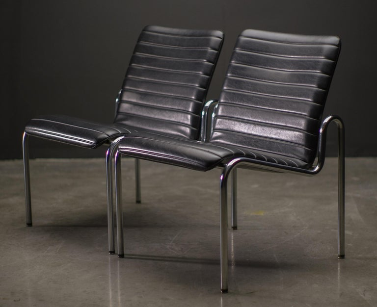 Pair of lounge chairs by Kho Liang Ie for Stabin Woerden, the Netherlands. Elegant Minimalist design by the Dutch modernist master.  Beautiful matte chrome frame with Naugahyde upholstery. Marked with label.