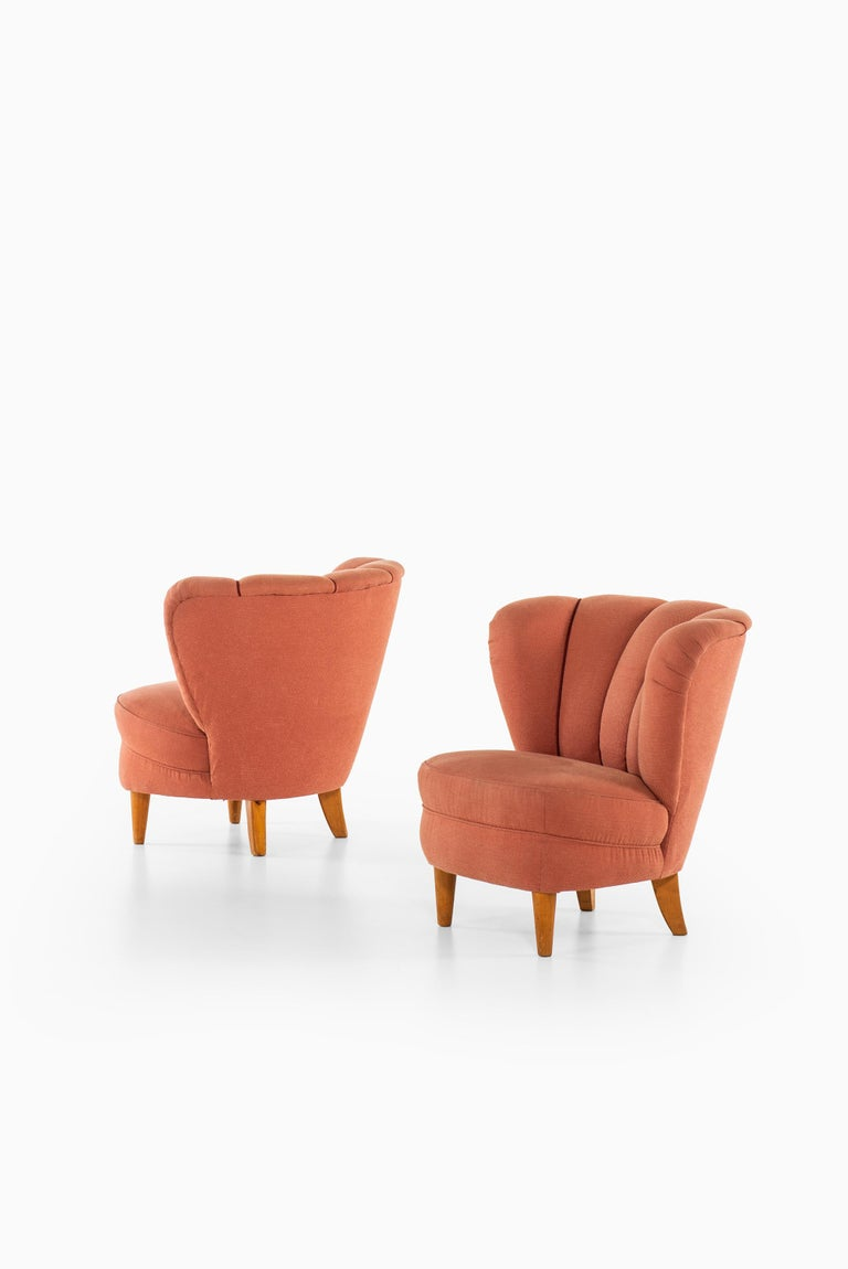 Rare pair of easy chairs in the manner of Otto Schulz. Produced in Sweden.