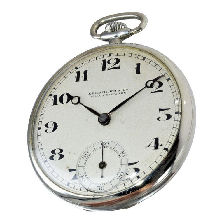 FACTORY / HOUSE: Eberhard & Co.  STYLE / REFERENCE: Opened Faced Pocket Watch METAL / MATERIAL: Nickel Silver DIMENSIONS: 41mm  CIRCA: 1930's MOVEMENT / CALIBER: Manual Winding / 15 Jewels  DIAL / HANDS: Original with Breguet Arabic Numerals / Blued