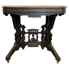 Ebonized Aesthetic Movement Parlor Table with Pink Marble Top and Gold Decor