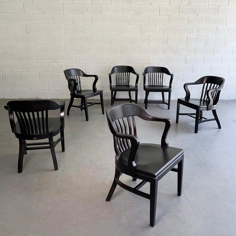 Classic, maple and oak, bank of England, courthouse, armchairs by Gunlocke, Sikes and Library Bureau Makers in an ebonized finish. The chairs differ ever so slightly due to the makers. Six available now, sold individually.