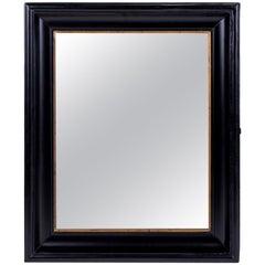 Ebonized Belgian Mirror Decorated in Giltwood Trim