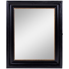 Ebonized Belgian Mirror Trimmed in Giltwood Decoration