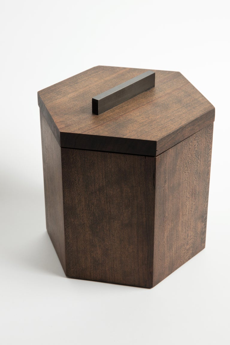 Our ebonized cherrywood ice bucket is handcrafted with solid cherry from Birmingham's urban forest. Modern geometric barware strikes a clean line on your counter. Store ice for cocktails or keep a bottle of your favorite white wine cool and crisp