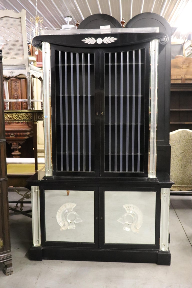 This is an original black lacquer and Lucite vitrine designed by Lorin Jackson for Grosfeld House circa 1940. The cabinet has it's original florescent lighting system and is in very good condition for its age and has no issues beyond minor wear from