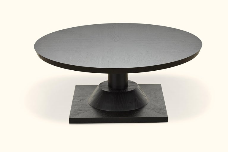 The Morro coffee table features a series of geometric shapes stacked on top of each other with solid wood details. Available in American walnut or white oak. Shown here in ebonized oak.  Available finishes may vary.   The Lawson-Fenning