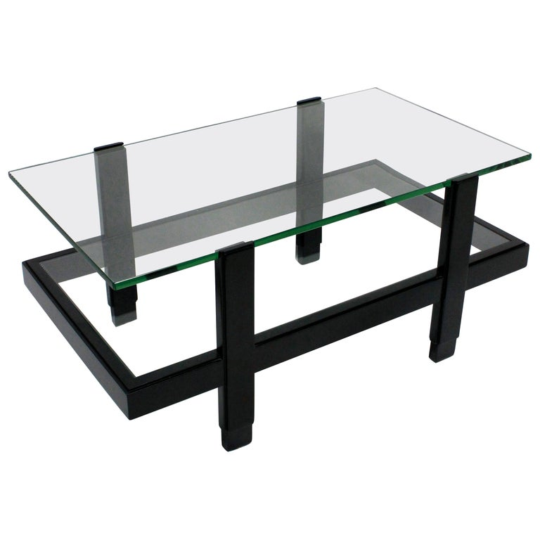 An Italian occasional table comprising two glazed tiers in black lacquered hardwood.