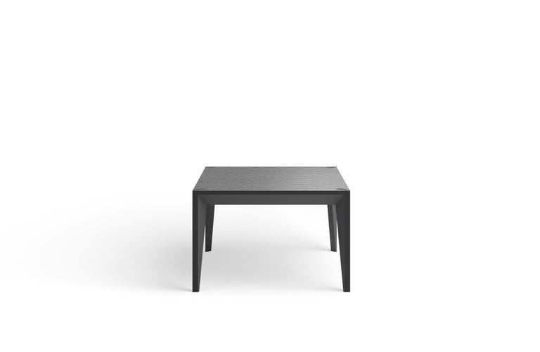 Merging clean lines with warm materials, the faceted geometry of the MiMi Square Coffee Table creates a slender, elegant profile punctuated with painted surfaces that capture light. This handcrafted modern and graceful design looks great from all