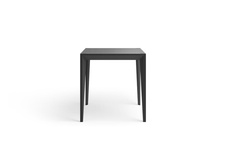 Merging clean lines with warm materials, the faceted geometry of the MiMi square table creates a slender, elegant profile punctuated with angled surfaces that capture light. The MiMi line was a NYCxDesign 2018 Honoree and German Design Award 2019